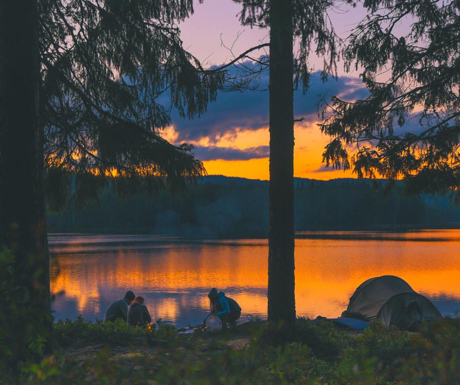 People camping near a lake